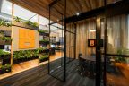 Meeting Room with Glass wall and black frames and orange highlights to match logo